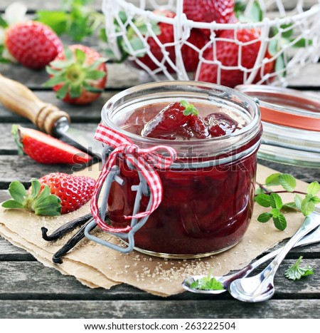 Strawberry jam ( marmalade ) and fresh raspberry on a rustic wooden table.Selective focus.  - stock photo