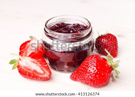 strawberry jam on the table - stock photo
