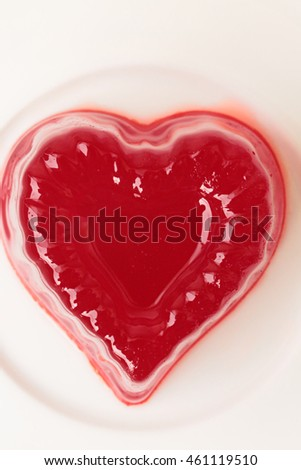 strawberry jelly in the shape of heart on a white background 10
