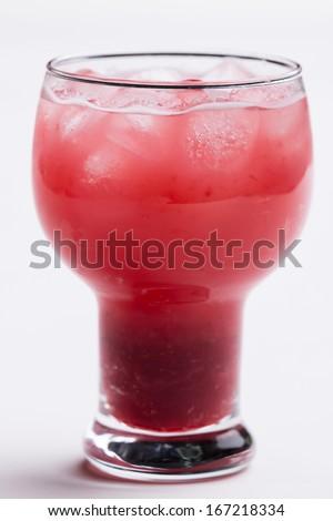 Strawberry juice, add ice, white background - stock photo