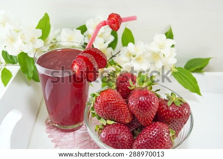 Strawberry juice and fresh strawberries served on the flowers decorated plate