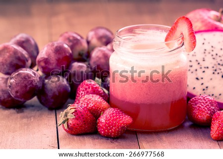 Strawberry juice blend  with mix fruit in sweet color - stock photo