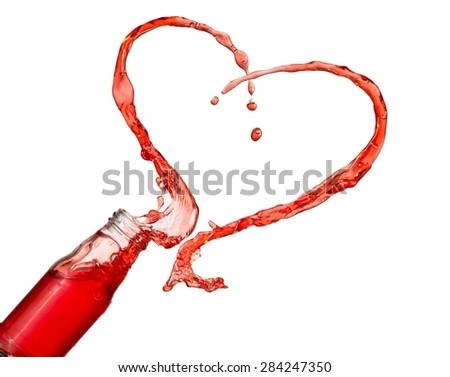 Strawberry juice heart splash from a bottle  - stock photo