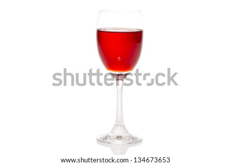 Strawberry juice in a glass of water, put the side on white background.