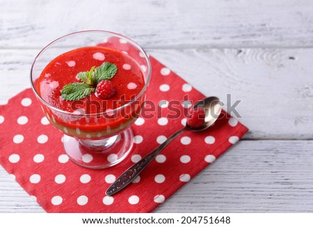 Strawberry, kiwi fruit and raspberry smoothies in glass bowl on color wooden background - stock photo
