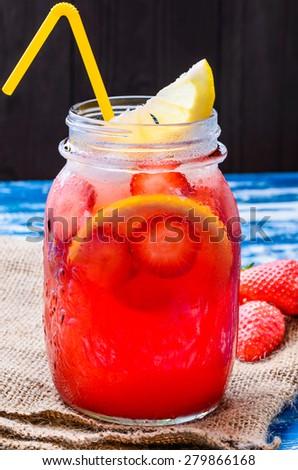 Strawberry lemonade, beverage.Fruit infused water with strawberries and lemon in mason jar. - stock photo