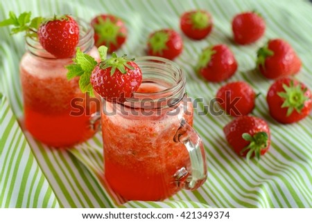 Strawberry lemonade with mint in jars