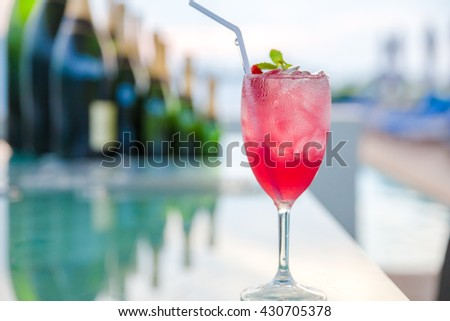Strawberry margarita cocktail on the bar - stock photo