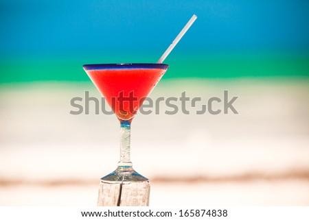 Strawberry margarita on the sandy white beach - stock photo