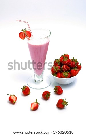 strawberry milkshake and fresh strawberries in a bowl