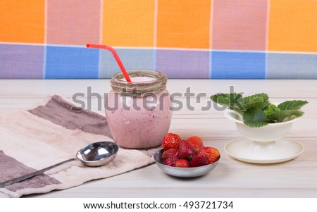 strawberry milkshake on a rustic table, strawberry yogurt, berry dessert drink