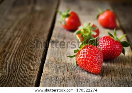 strawberry on a dark wood background - stock photo