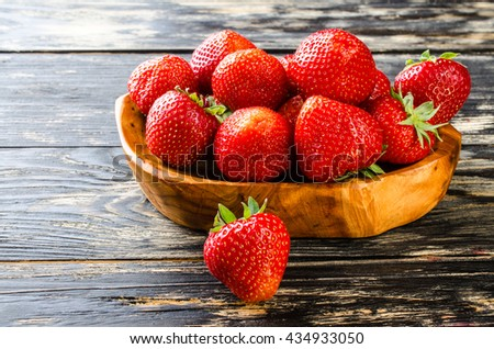 Strawberry on a dark wooden background. Close-up. - stock photo