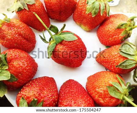 strawberry on a white  plate