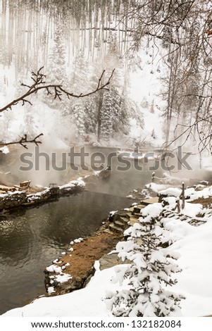 Strawberry Park Hot Springs natural hot springs in winter after freshly fallen snow - stock photo