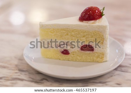 Strawberry Shortcake with dish on Marble Table selective focus