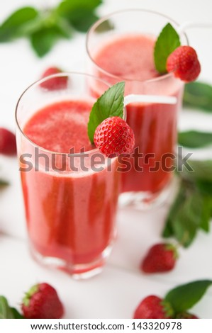 Strawberry smoothie decorated with mint