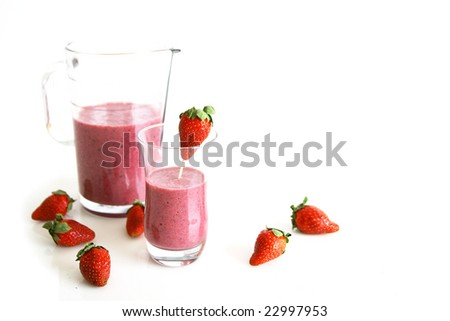 Strawberry smoothie, fresh fruits and pitcher - stock photo