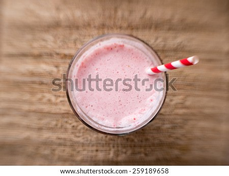 Strawberry smoothie from above with selective focus - stock photo