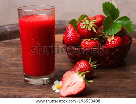 Strawberry smoothie in glass jar, over old wood table