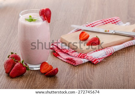 Strawberry smoothie, nice and clean, fresh fruits, leaf of mint - stock photo