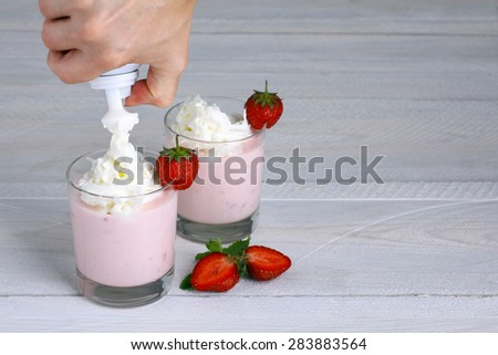 Strawberry smoothie with whipped cream and mint. Strawberry dessert, yogurt and cocktails - stock photo