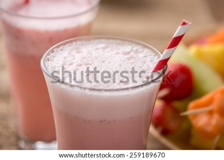 Strawberry smoothies and  fruit kabobs - fruit on skewers - on tray - stock photo
