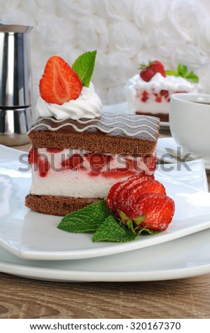 Strawberry souffle on a chocolate sponge cake