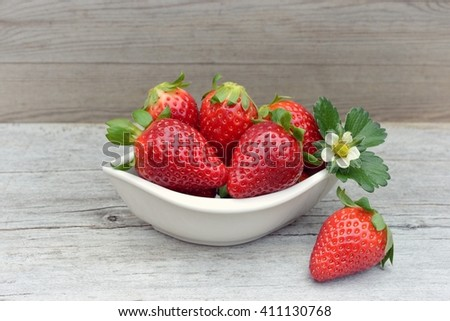 Strawberry. Strawberry, strawberries, Strawberry on wood background. Red strawberries, strawberries,strawberries,strawberries . Strawberry with green leaves. Healthy strawberries. strawberry flower. - stock photo