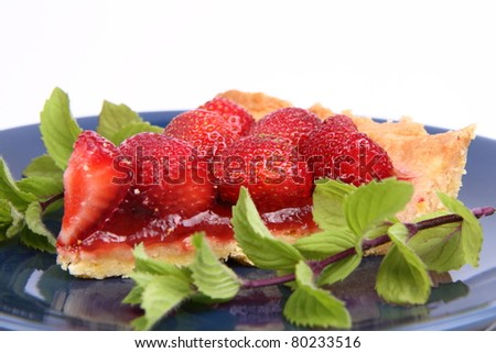 Strawberry Tart portion decorated with mint twigs