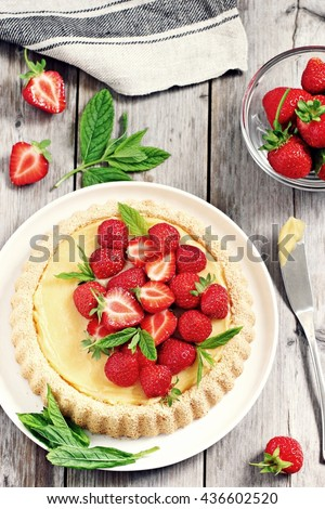 Strawberry tart with lemon cream and mint. Rustic style.Selective focus - stock photo