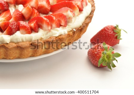 Strawberry tart with mascarpone cream on white background - stock photo