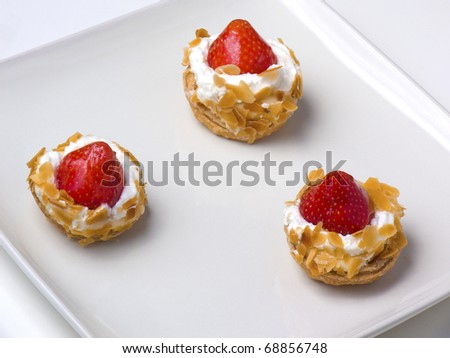 Strawberry tarts on a sqare plate, closeup