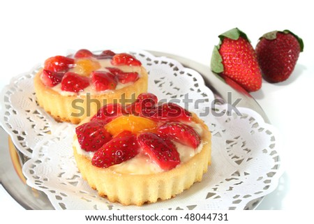 Strawberry tarts with mint on a silver platter