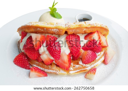 Strawberry waffles and honey on a white plate on a white background.