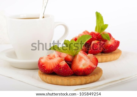 Strawberry with a mint and cup of coffee on a white background - stock photo