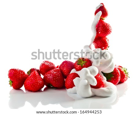strawberry  with cream isolated on white reflexive background