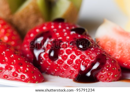 Strawberry with drops of balsamic vinegar - stock photo