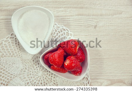 Strawberry with sugar. Strawberries in the bowl, sugar in another bowl - stock photo