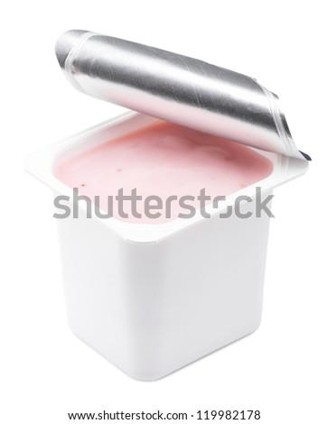Strawberry yogurt in opened yogurt pot. Isolated on white. - stock photo