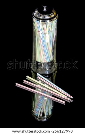 Straws and straw holder with reflection - stock photo