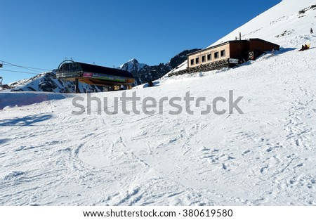 Strbske Pleso, HIGH TATRAS, SLOVAKIA - MARCH 13, 2012: Mountain view on the lift station and restaurant in High Tatras.