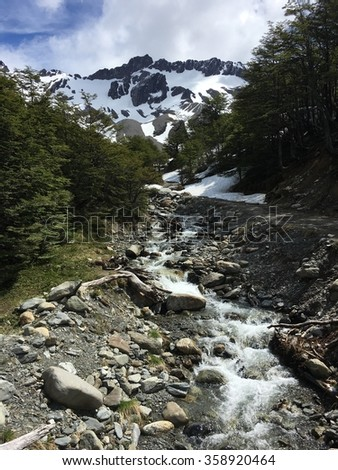 Stream and mountains in Ushuaia, Argentina - stock photo