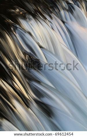 Stream blurred water in small waterfall - stock photo
