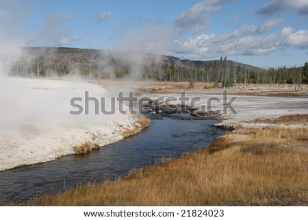 Stream Flowing through the Lower Geyser Basin - stock photo