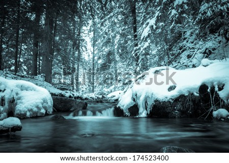 Stream in winter. Ice on river in frosty winter - stock photo