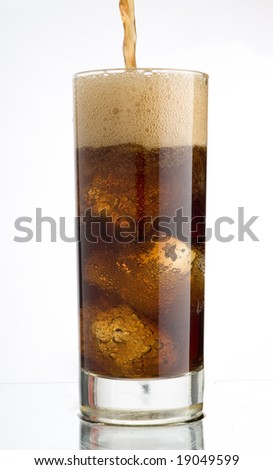 Stream of cola soda in a glass