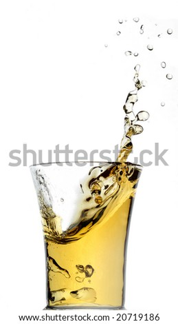 Stream of juice flying out from a glass - stock photo