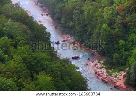 Stream of water flowing at the bottom of a canyon - stock photo