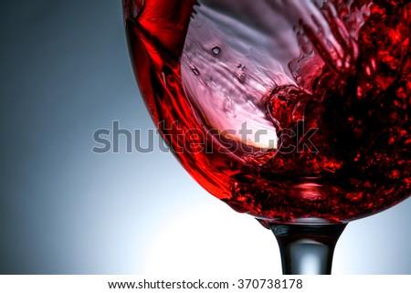 stream of wine being poured into a glass close up,  wine, splashing, splash,  - stock photo